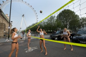 Beach Volleyball team 'stop traffic' to remind commuters to avoid busy roads during the Olympics