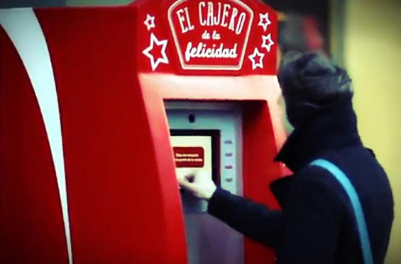 Coca-Cola ATM gives away free money, asks people to use it to help others.