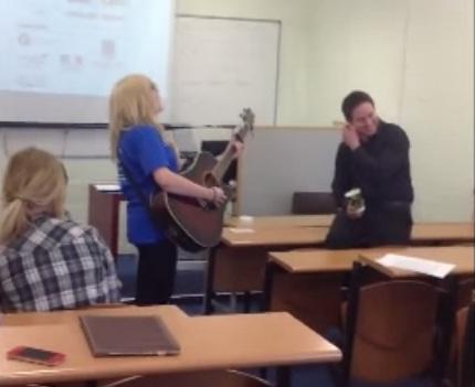 student serenades lecturer