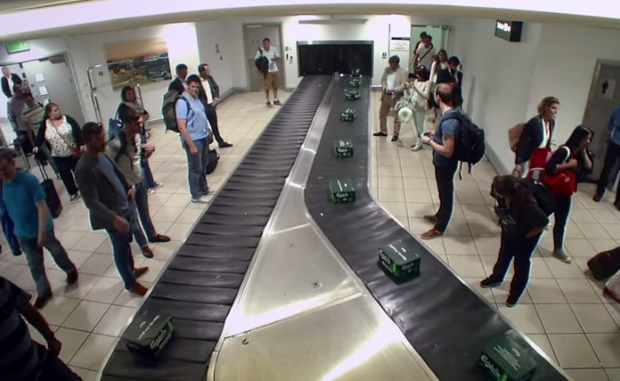 Carlsberg surprise holidaymakers with free beer on baggage carousel