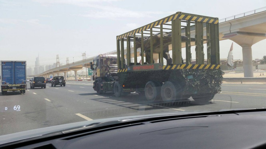 Dinosaur in truck on Sheikh Zayed Road Dubai IMG World of Adventures