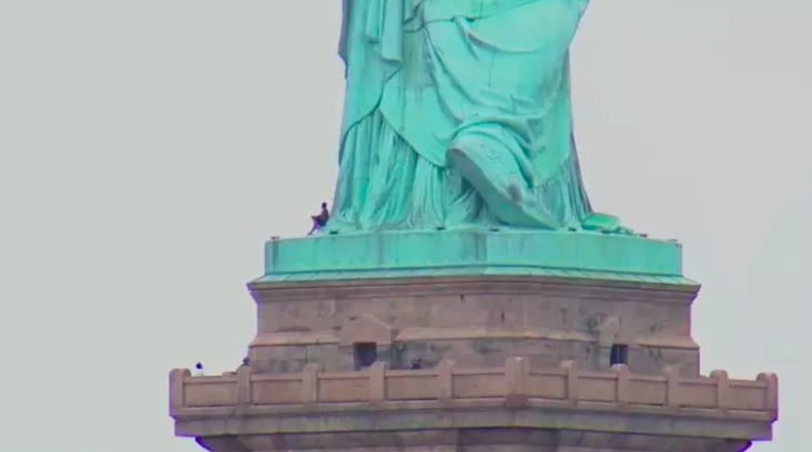 Woman Climbs Statue Of Liberty To Protest Separation Of Migrant